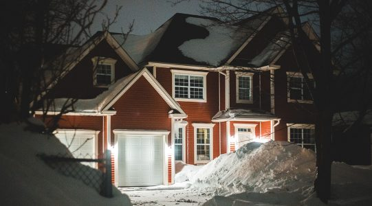 image of a house covered in snow